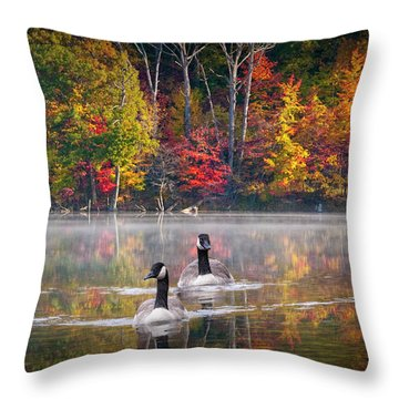 Two Canadian Geese Swimming In Autumn Throw Pillow