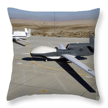 Two Global Hawks Parked On A Ramp Throw Pillow by Stocktrek Images