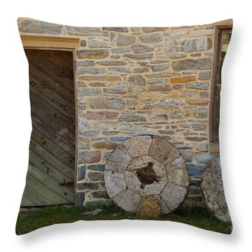 Two Mill Stones Against Building Throw Pillow