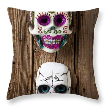 Two Skull Masks Throw Pillow by Garry Gay