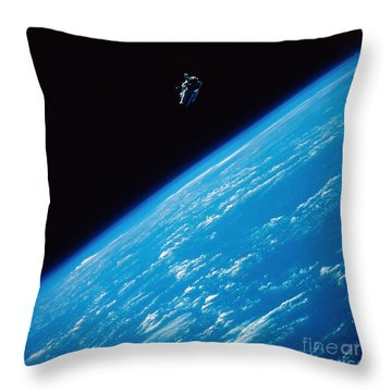 Unattached Space Walk Throw Pillow by Stocktrek Images