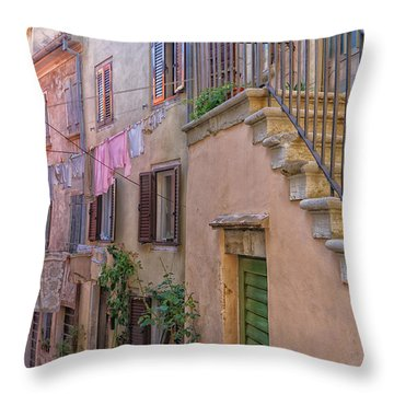 Urban View With Laundary Throw Pillow by Uri Baruch