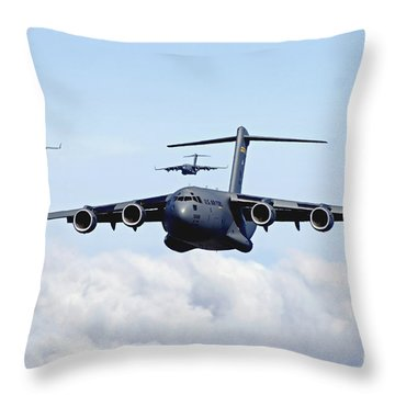 Throw Pillow featuring the photograph U.s. Air Force C-17 Globemasters by Stocktrek Images