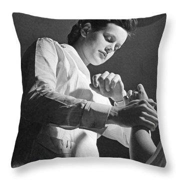 Us Navy Nurse Taking A Pulse Throw Pillow