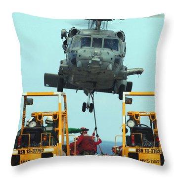 U.s. Navy Sailors Attach A Sling Throw Pillow