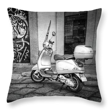 Throw Pillow featuring the photograph Vespa Scooter In Milan Italy In Black And White  by Carol Japp