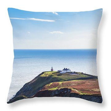 Throw Pillow featuring the photograph View Of The Trails On Howth Cliffs With The Lighthouse In Irelan by Semmick Photo