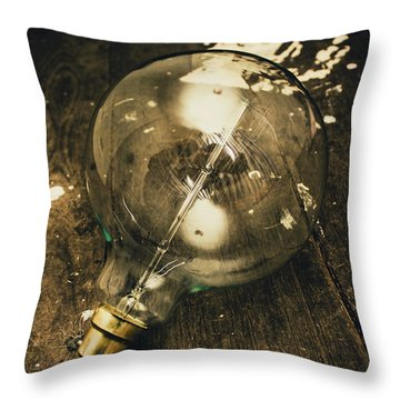 Vintage Light Bulb On Wooden Table Throw Pillow