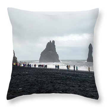 Throw Pillow featuring the photograph Visitors In Reynisfjara Black Sand Beach, Iceland by Dubi Roman