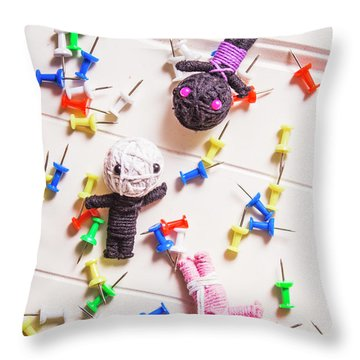 Voodoo Dolls Surrounded By Colorful Thumbtacks Throw Pillow