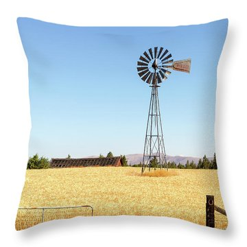 Water Pump Windmill At Wheat Farm In Rural Oregon Throw Pillow by David Gn