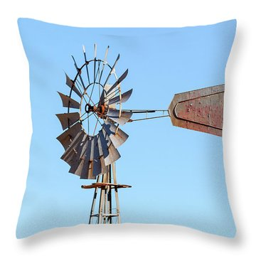 Water Pump Windmill On Blue Sky Background Throw Pillow by David Gn