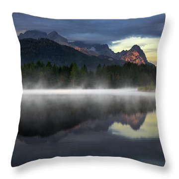 Wetterstein Mountain Reflection During Autumn Day With Morning Fog Over Geroldsee Lake, Bavarian Alps, Bavaria, Germany. Throw Pillow