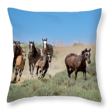 wild mustangs on the run to the water hole in Sand Wash Basin Throw Pillow