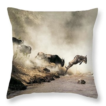 Wildebeest Leaping In Mid-air Over Mara River Throw Pillow