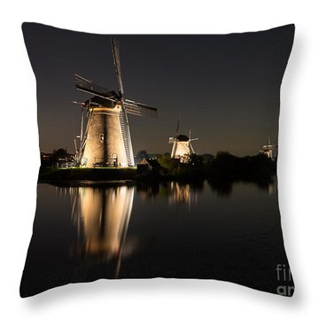 Windmills Illuminated At Night Throw Pillow