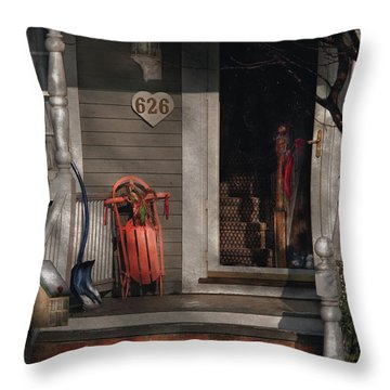 Winter - Rosebud And Shovel Throw Pillow by Mike Savad