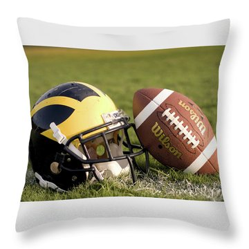 Wolverine Helmet With Football On The Field Throw Pillow