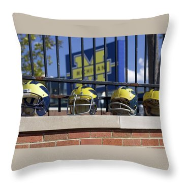 Wolverine Helmets Of Different Eras On Stadium Wall Throw Pillow