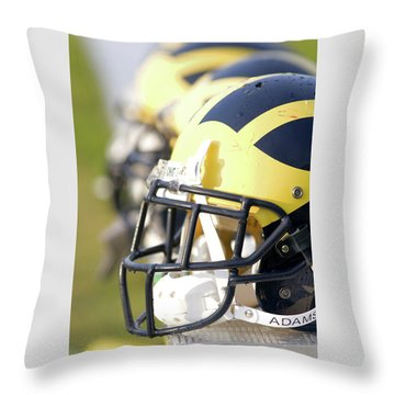 Throw Pillow featuring the photograph Wolverine Helmets On A Bench In The Morning by Michigan Helmet