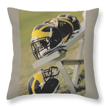 Throw Pillow featuring the photograph Wolverine Helmets On A Football Bench by Michigan Helmet