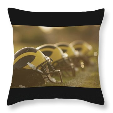 Throw Pillow featuring the photograph Wolverine Helmets Sparkling In Dawn Sunlight by Michigan Helmet
