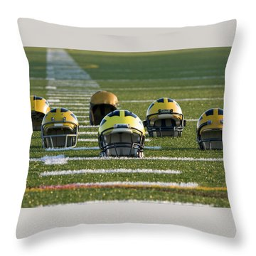 Throw Pillow featuring the photograph Wolverine Helmets Throughout History On The Field by Michigan Helmet