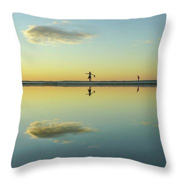 Woman And Cloud Reflected On Beach Lagoon At Sunset Throw Pillow