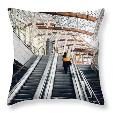 Woman Going Up Escalator In Milan, Italy Throw Pillow
