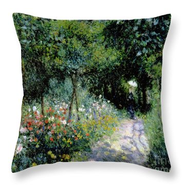 Woman In A Garden Throw Pillow by Pierre Auguste Renoir