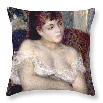 Woman In An Armchair Throw Pillow by Pierre Auguste Renoir