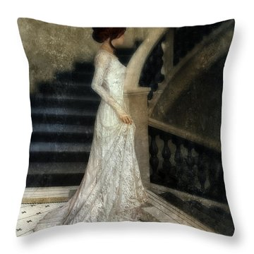 Woman In Lace Gown On Staircase Throw Pillow by Jill Battaglia