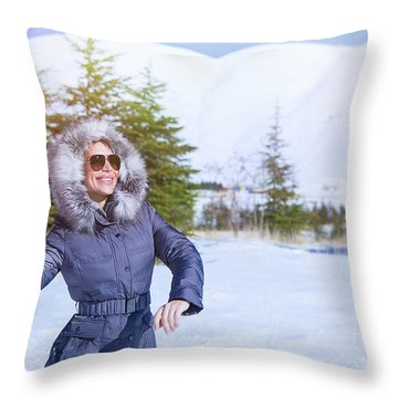 Woman Playing In Winter Park Throw Pillow