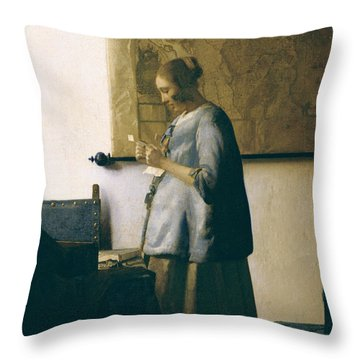 Woman Reading A Letter Throw Pillow by Jan Vermeer