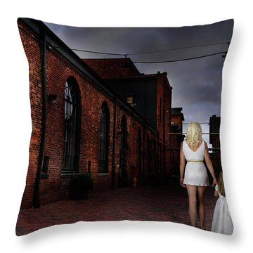 Woman Walking Away With A Child Throw Pillow by Oleksiy Maksymenko