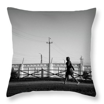 Throw Pillow featuring the photograph Woman Walking In Industry by John Williams