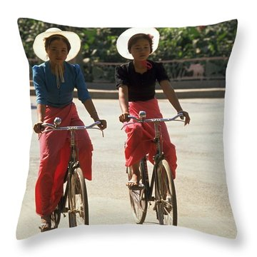 Xishuangbanna Cyclists Throw Pillow