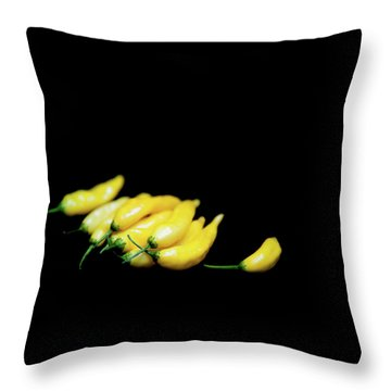 Yellow Chillies On A Black Background Throw Pillow