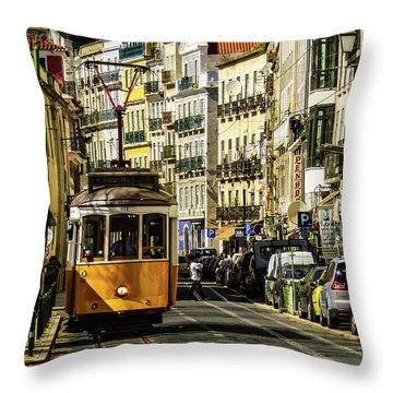 Yellow Tram In Downtown Lisbon, Portugal Throw Pillow