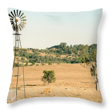 Throw Pillow featuring the photograph Cows And A Windmill In The Countryside. by Rob D Imagery