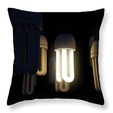 Single Light Bulb Illuminated In Collection Throw Pillow