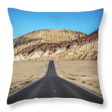 Throw Pillow featuring the photograph Lonely Road In Death Valley National Park In California by Alex Grichenko