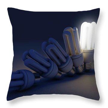 Single Light Bulb Illuminated In Row Throw Pillow