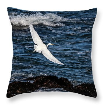 A Great Egret Soars Over Waves Throw Pillow