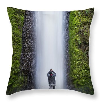 A Man Photographing A Waterfall Throw Pillow