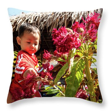 A Small Person With Reflected Flowers Throw Pillow