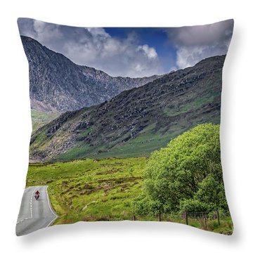 Biker In Snowdonia Wales Throw Pillow