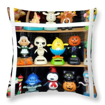 Bobbleheads In Store Window In Schroon Lake Ny In Adirondacks Throw Pillow