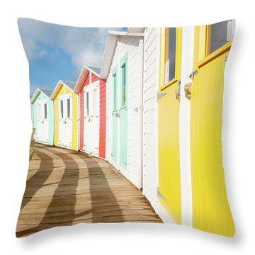 Colourful Bude Beach Huts Throw Pillow