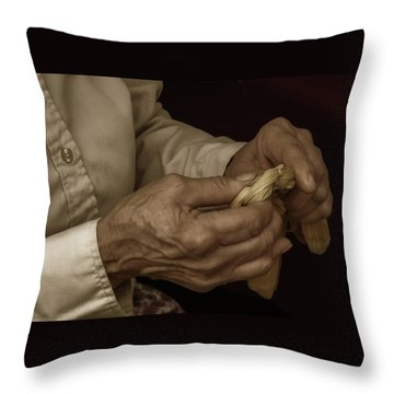 Throw Pillow featuring the photograph Corn Husk Doll Maker by Guy Whiteley